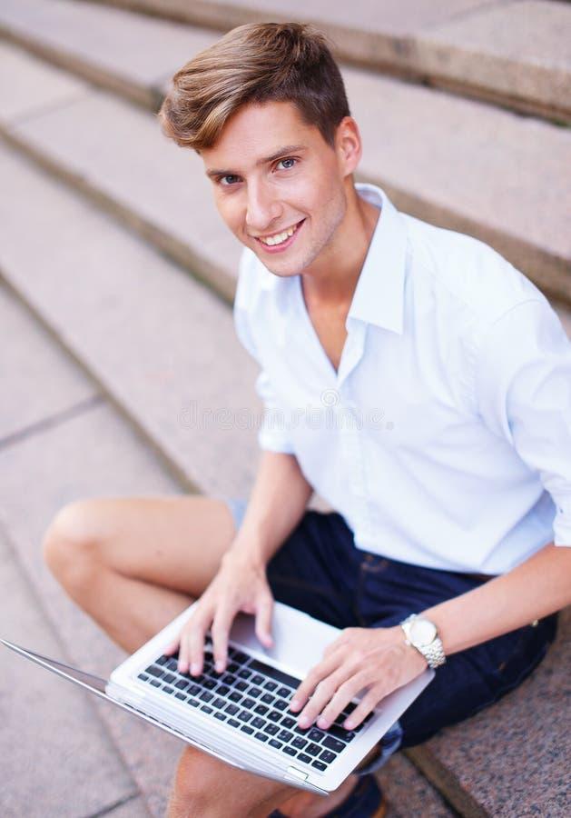 Young Man With Laptop Stock Photos