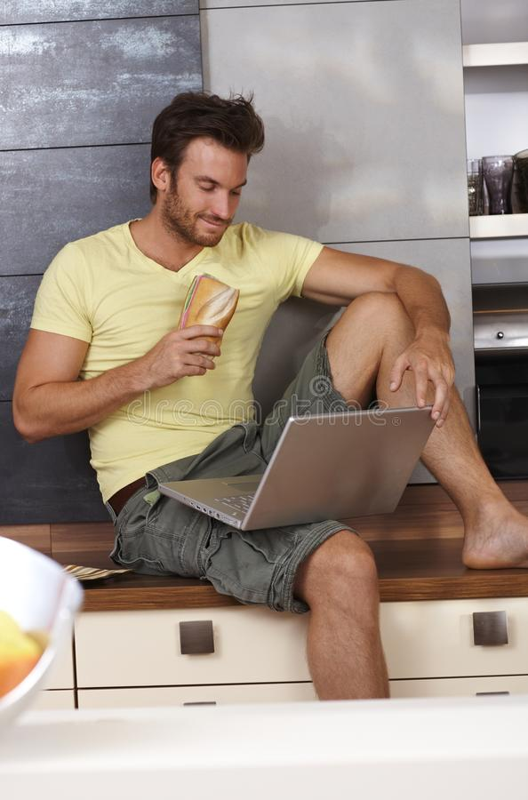 Download Young Man With Laptop In Kitchen Stock Image - Image: 33785895