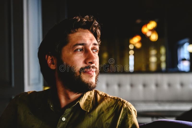 Young man with latin beard looking to infinity thinking about future business.  stock photos