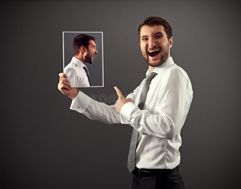 Young man laughing at danger royalty free stock photo