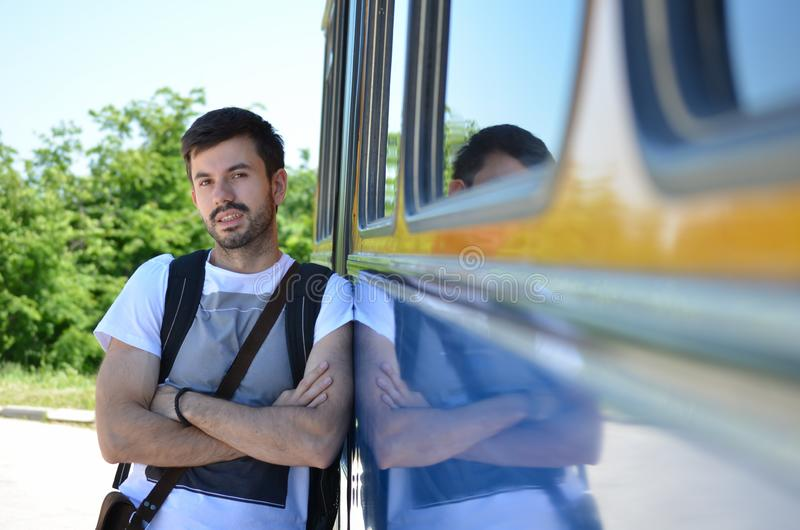 Young man leaning on a bus royalty free stock images