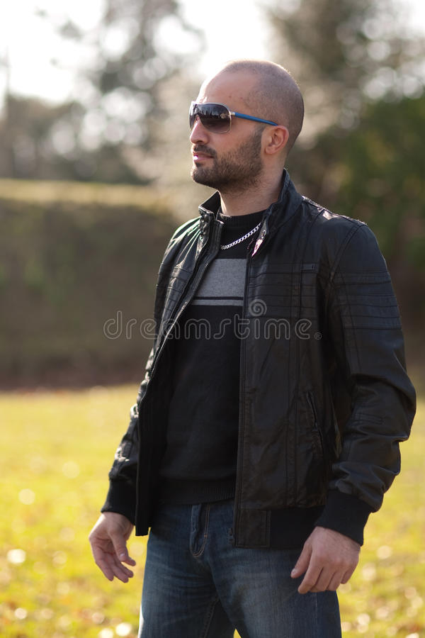 Download Young Man With A Leather Jacket Stock Photo - Image of bald, male: 18691276