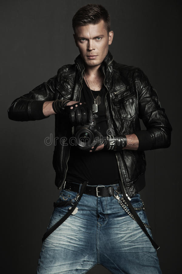 Young man in a leather jacket royalty free stock image