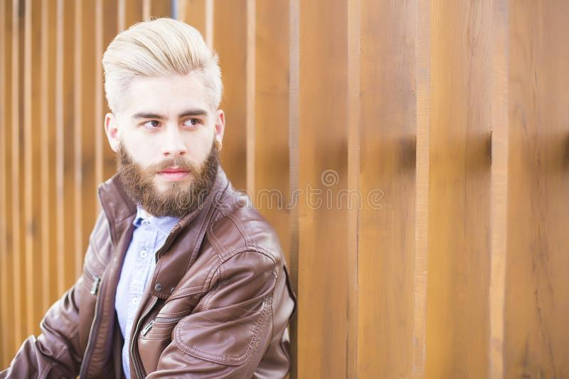 Young man in leather jacket stock image