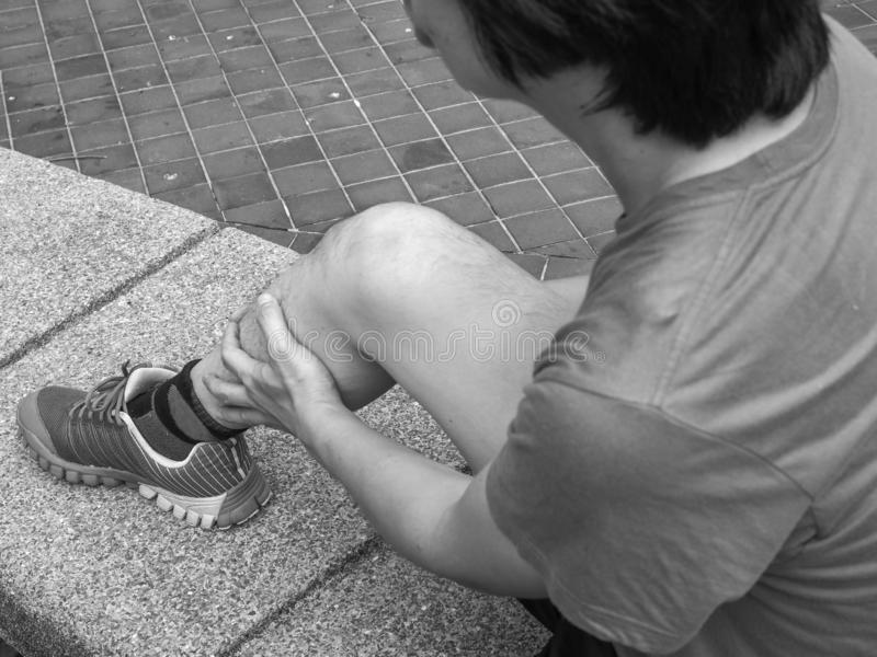 Young man with leg pain for run.  stock images
