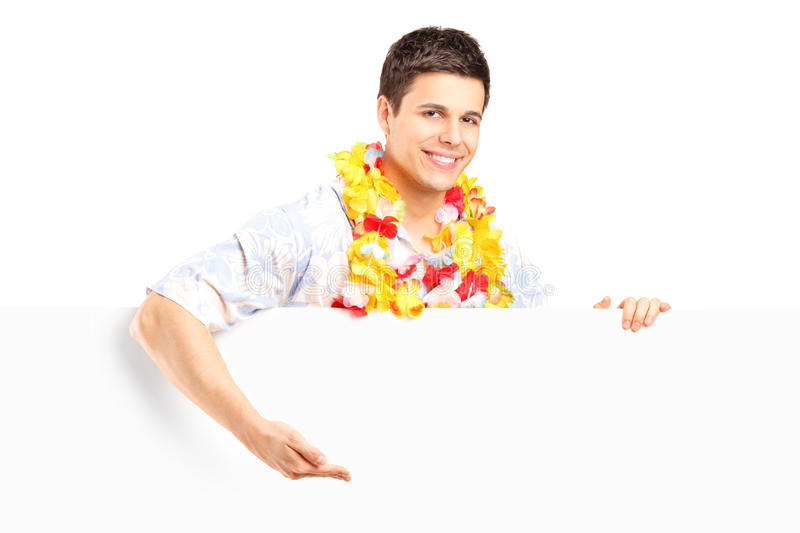 Young Man With Lei Around His Neck Behind A Panel Stock Photo