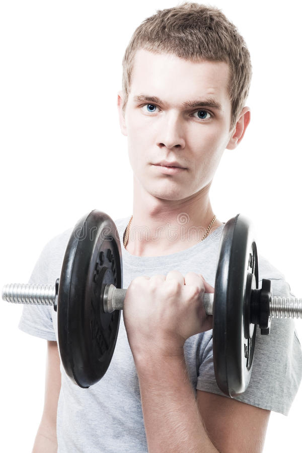Young man lift weight in gym