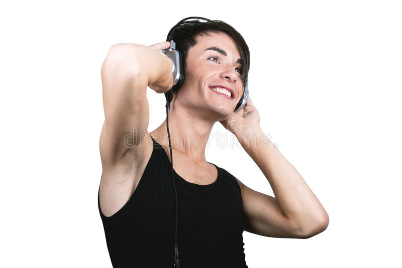 Young man listening music stock photography