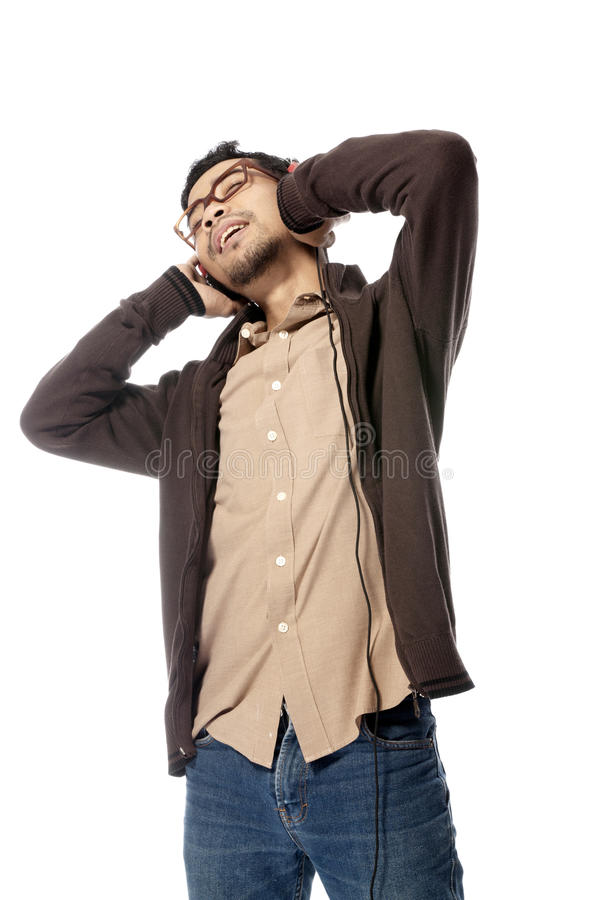 Download Young Man Listening Music stock photo. Image of head - 25842180