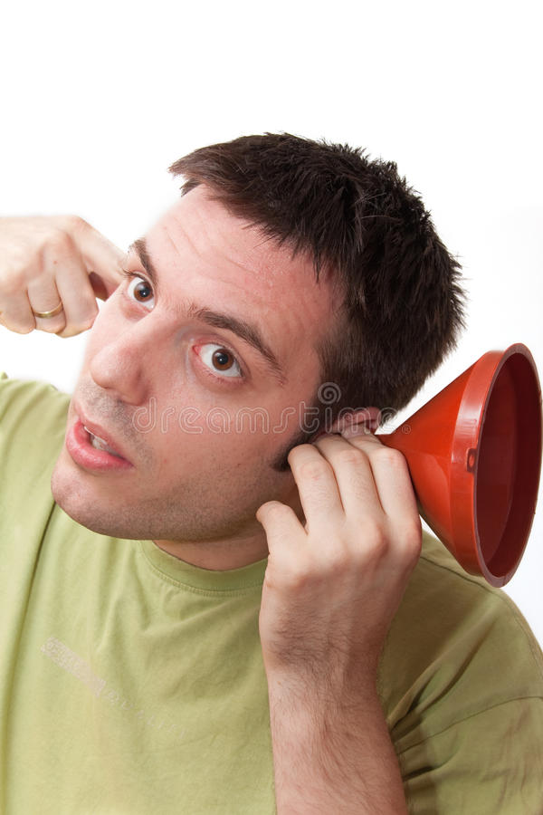 Free Young Man Listening Through A Funnel Stock Photo - 12361770