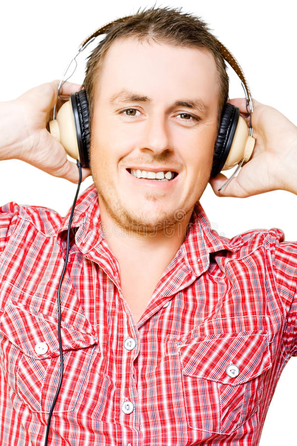 Download Young Man Listening To Music Through Earphones Stock Image - Image of entertain, accoustics: 26644747