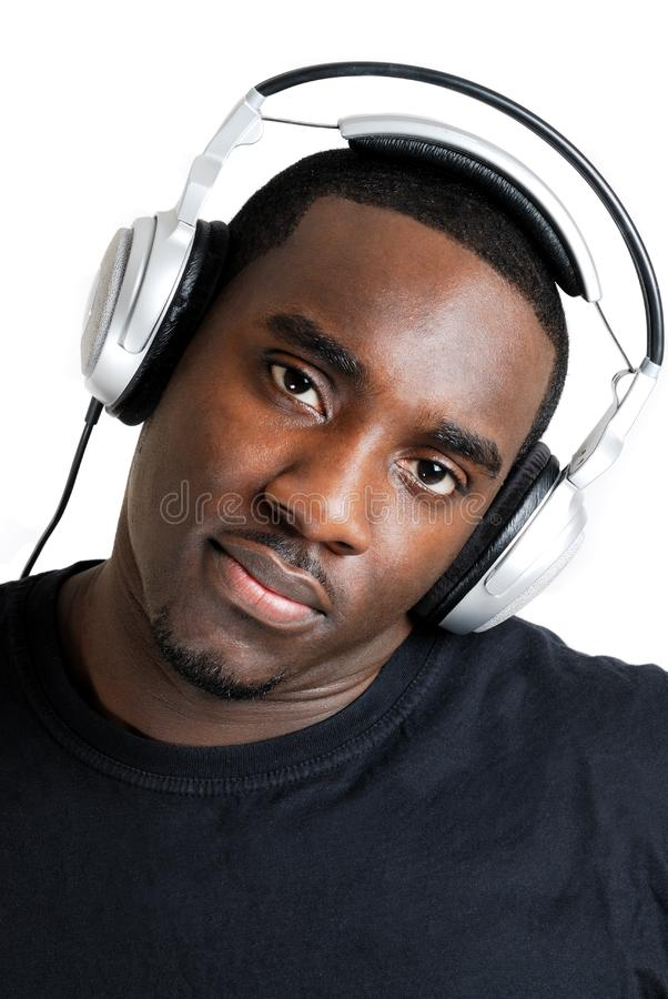Download Young Man Listenning To Music On Headphones Stock Image - Image of headphones, student: 10200319