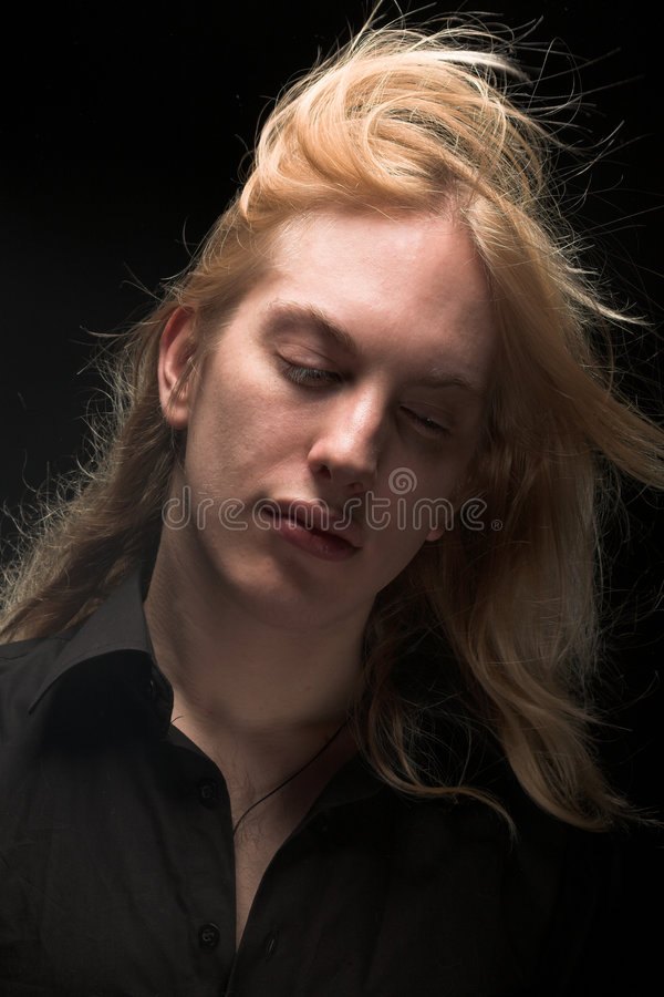 Young Man With Long Blond Hair Royalty Free Stock Images