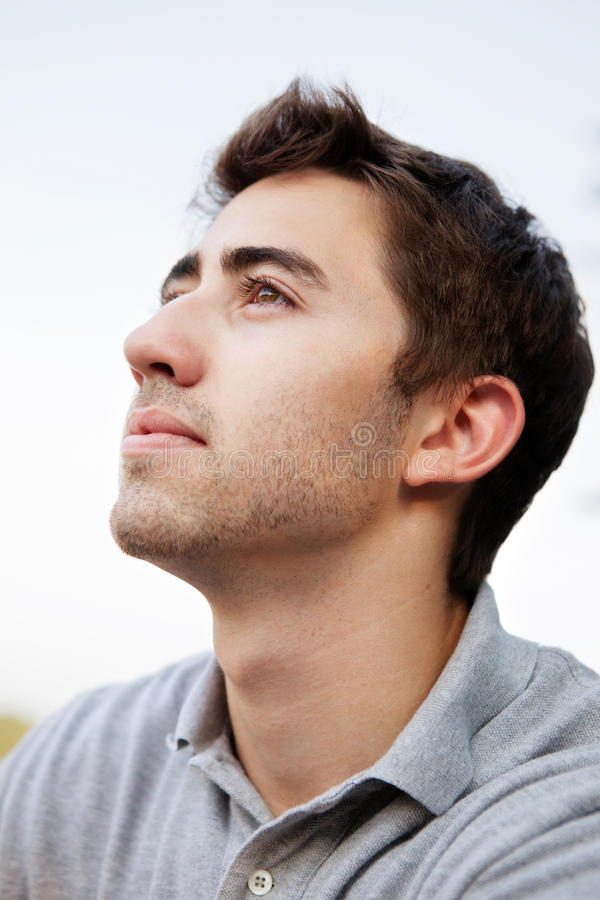 Download Young man looking away stock photo. Image of away, thinking - 25338966