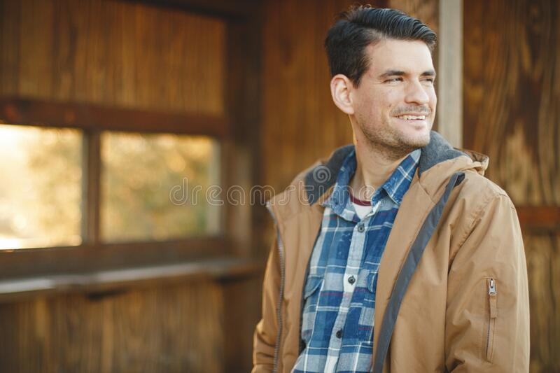 Young Man In Jacket Looking Back Smiling