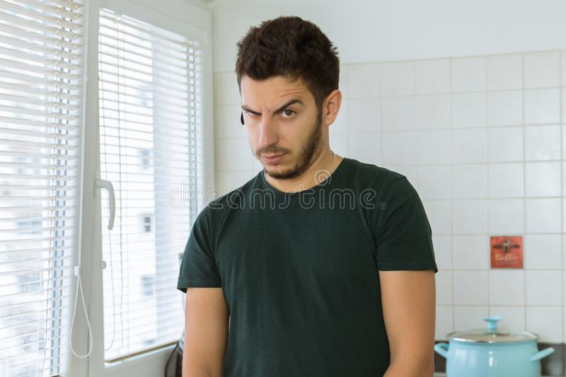 Young man looking at the camera in surprise. stock image