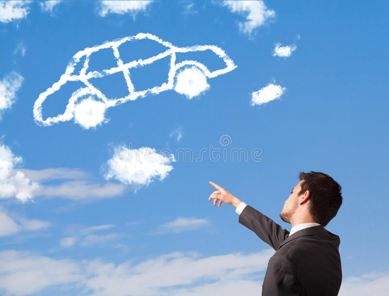 Young man looking at car cloud on a blue sky. Handsome young man looking at car cloud on a blue sky royalty free stock photography