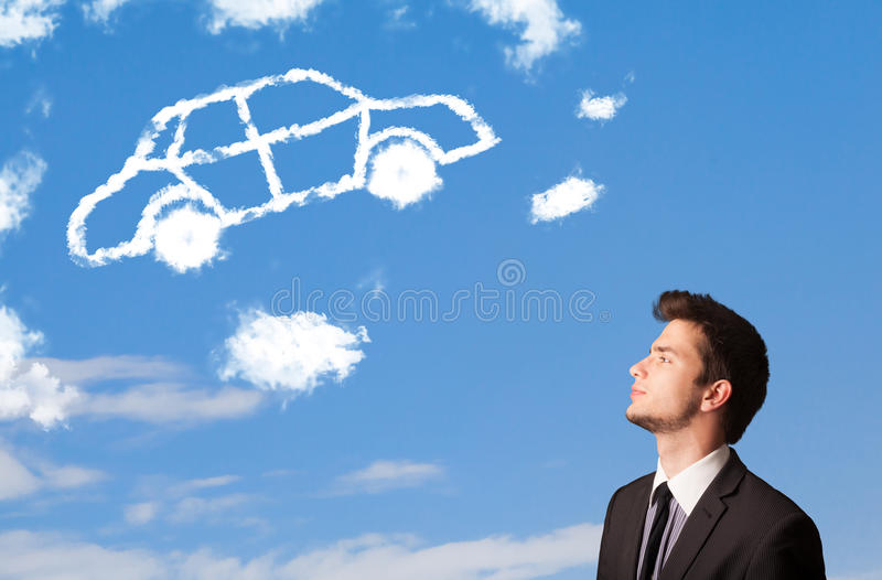 Young man looking at car cloud on a blue sky. Handsome young man looking at car cloud on a blue sky stock photography