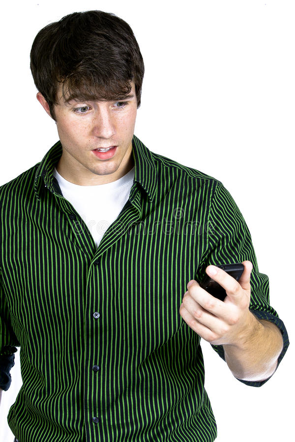 Download Young Man Looking At Cell Phone Stock Photo - Image: 21124918