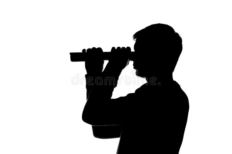Young man looking through curled paper, sheet of paper, telescope. Young man looking through curled paper, a sheet of paper, the telescope - a dark silhouette stock photo