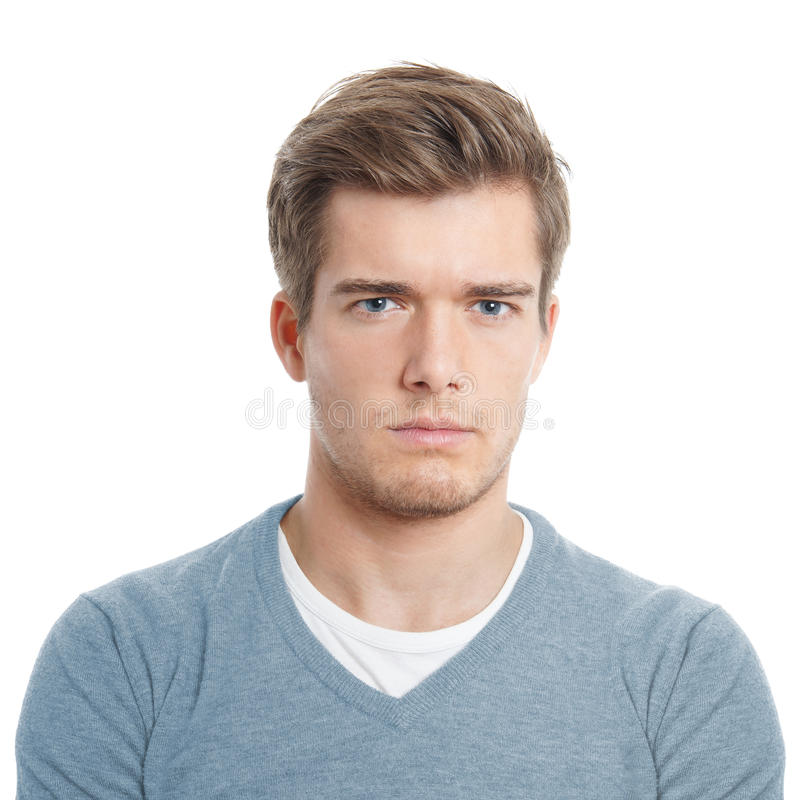 Young man looking displeased stock photos