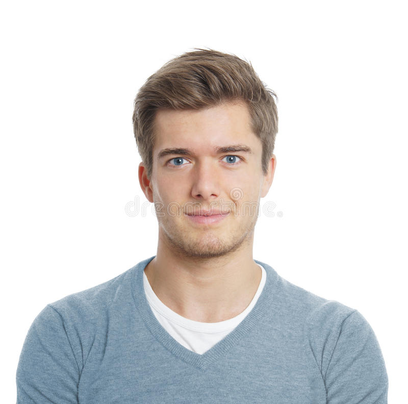 Young man looking pleased stock photo