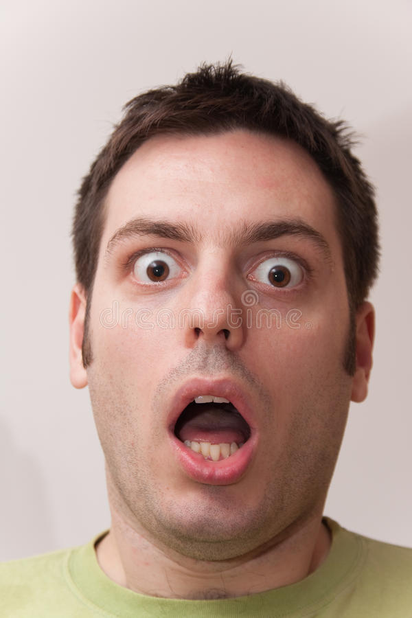 Free Young Man Looking Scared And Shocked Stock Photography - 14663052