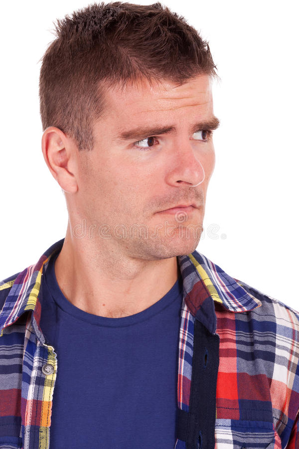 Download Young Man Looking Suspiciously To A Side Stock Photos - Image: 26706173