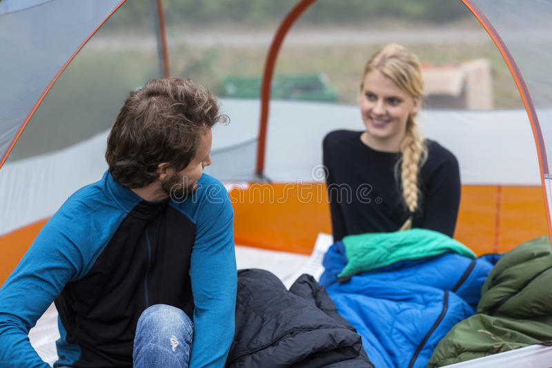 Young Man Looking At Woman In Tent stock images