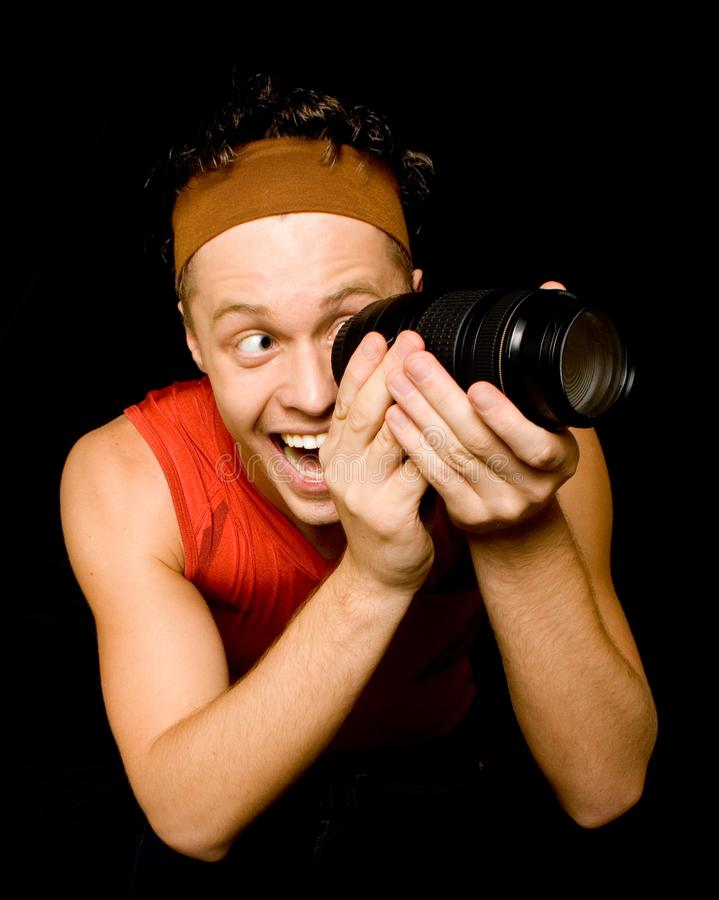 Download Young Man Looks Through Camera Lens Stock Photo - Image: 7868364