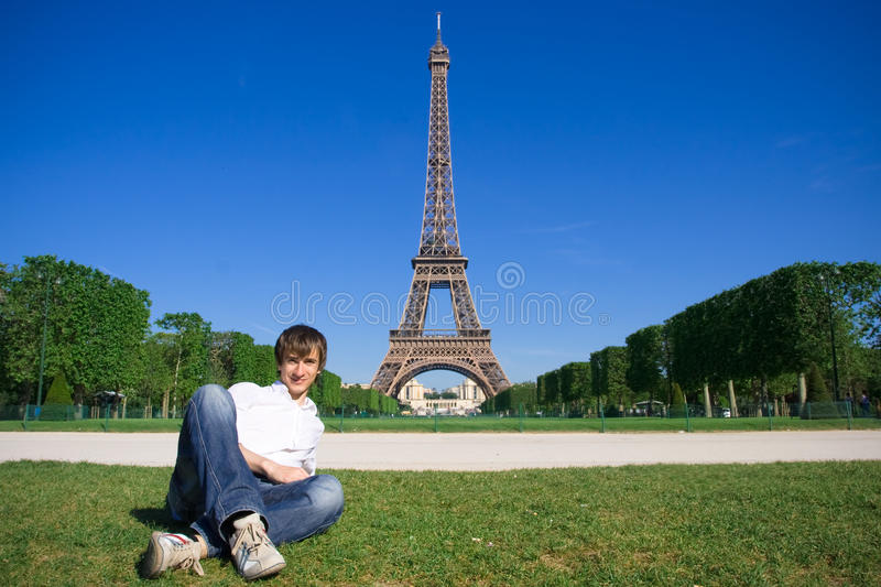 Young man lying on the Champs de Mars stock photos