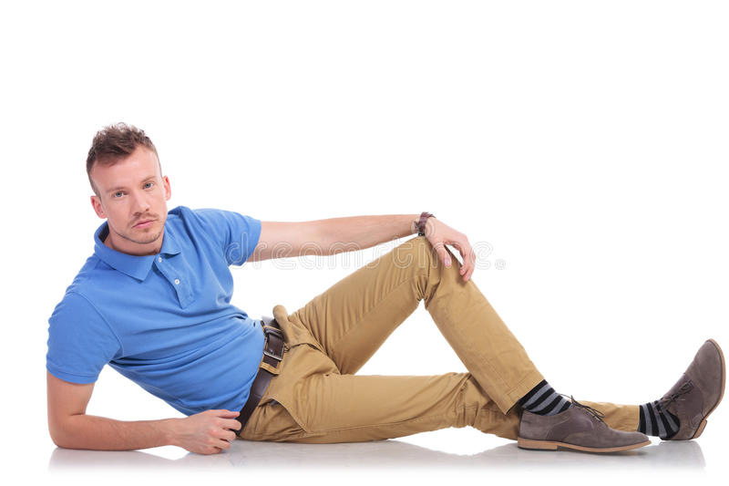 Young man lying on the floor royalty free stock photos