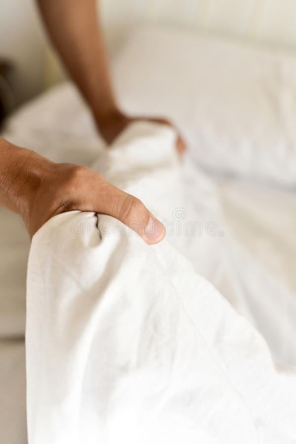 Young man making the bed royalty free stock photos