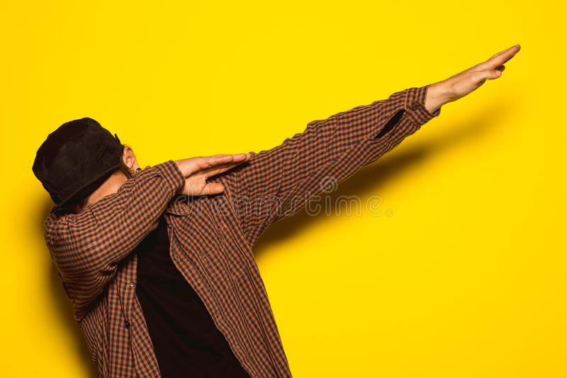Young man making DAB. Concept of dabbing royalty free stock images