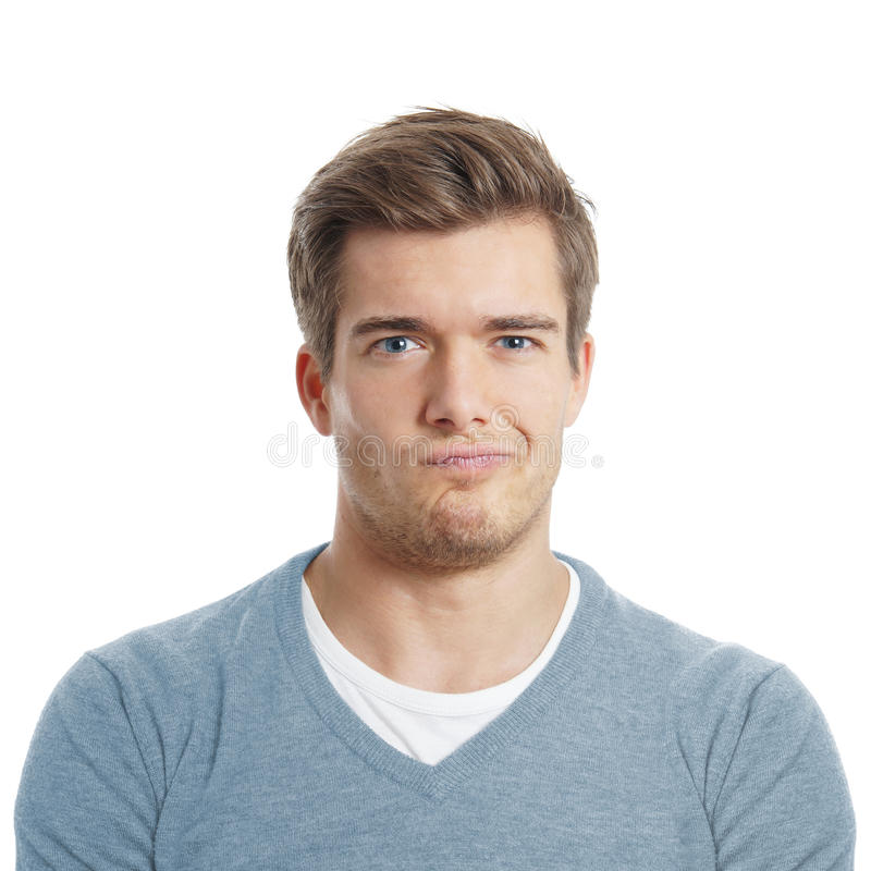 Young man making a face stock photos