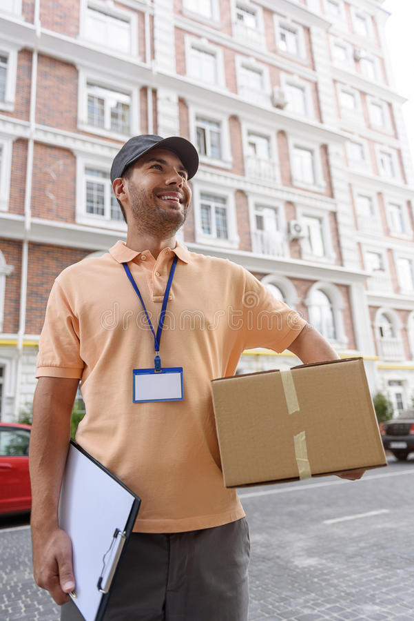 Young man making home delivery royalty free stock photo