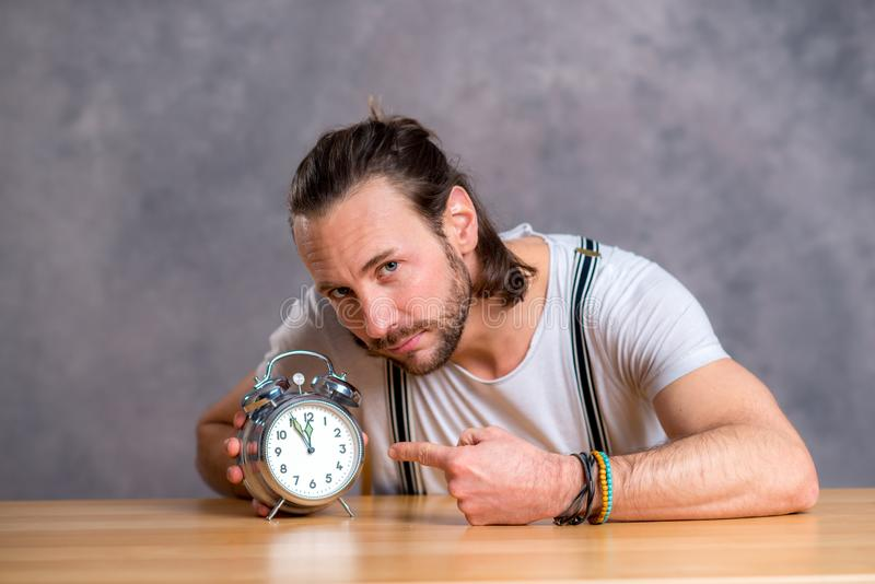 Young man man with clock royalty free stock image