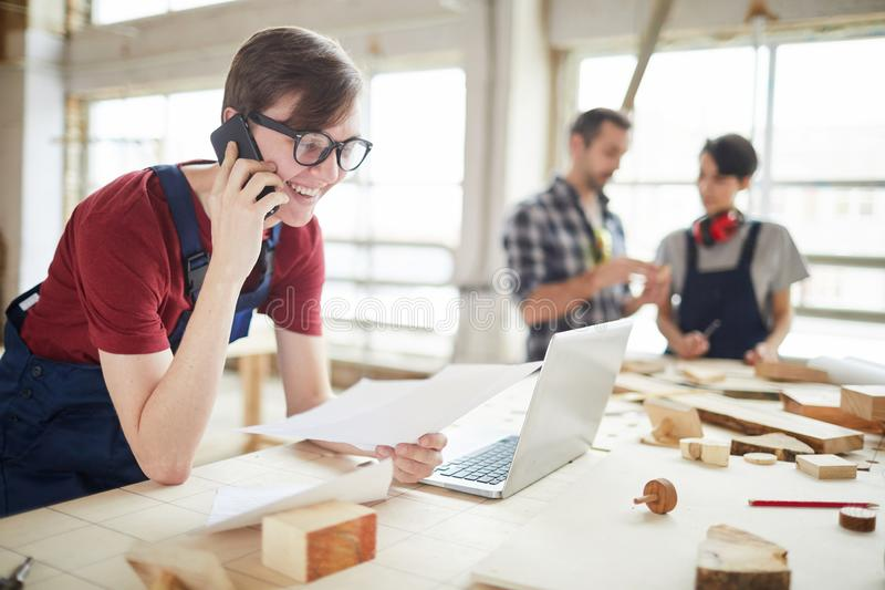 Young Man Managing Carpentry Business stock image