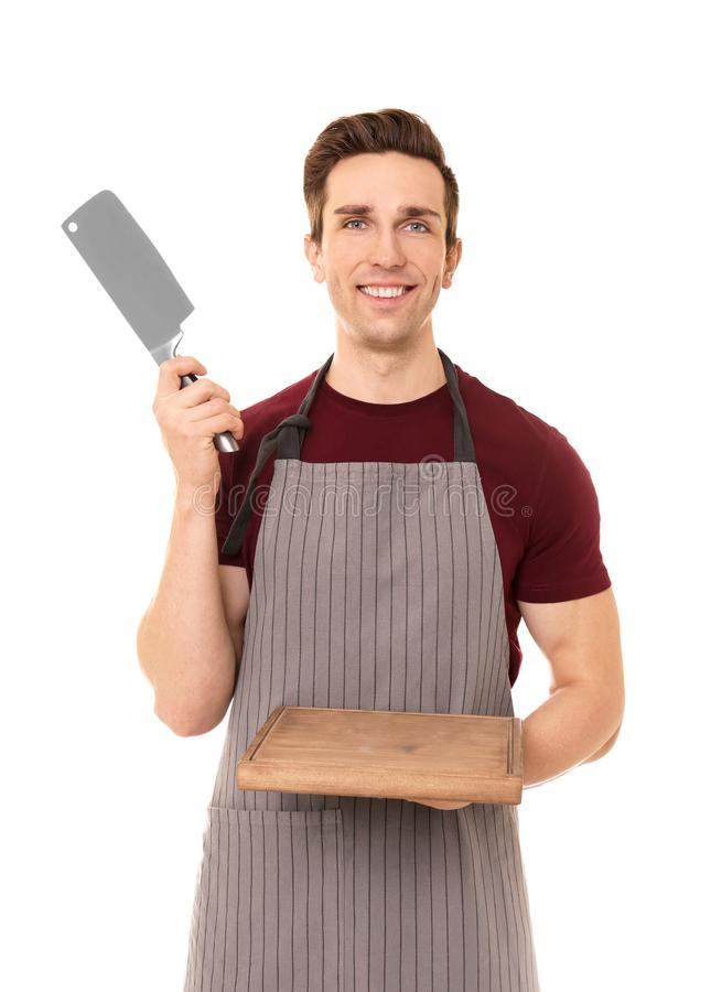 Young man with meat knife and board, isolated stock photography