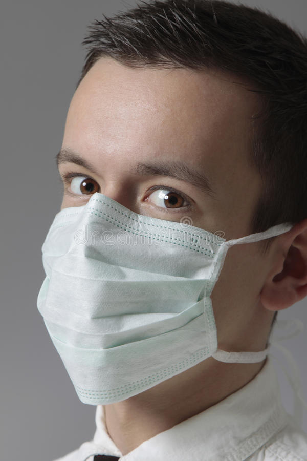 young man with medical mask royalty free stock photos