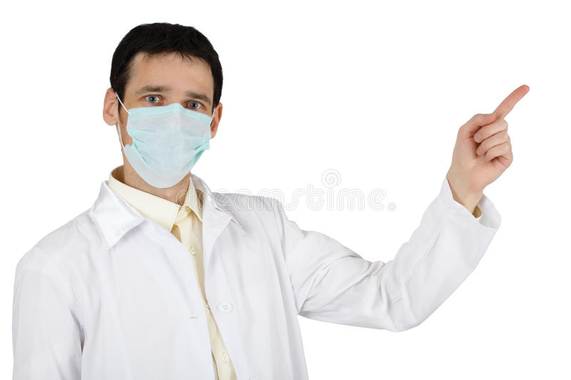 Young man in medical mask points finger royalty free stock image