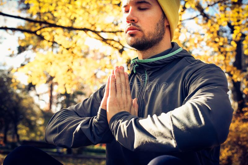 Young man meditation in nature. Eyes closed. stock images