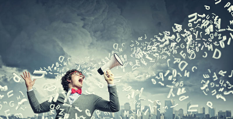 Young man with megaphone royalty free stock images