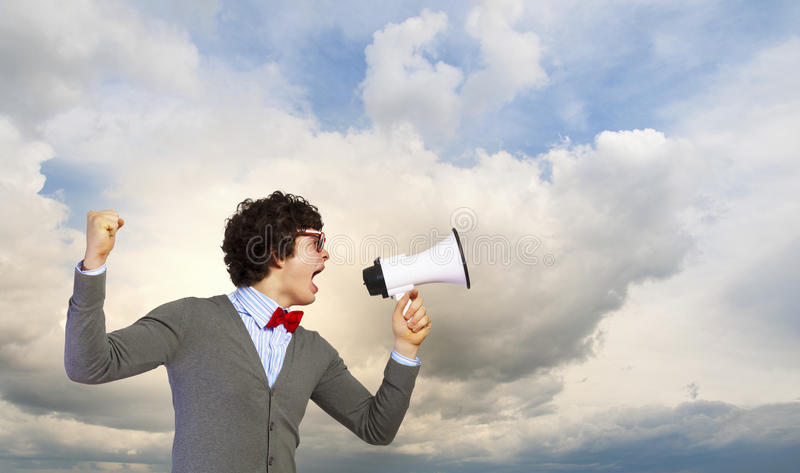 Download Young man with megaphone stock photo. Image of emotion - 33387042