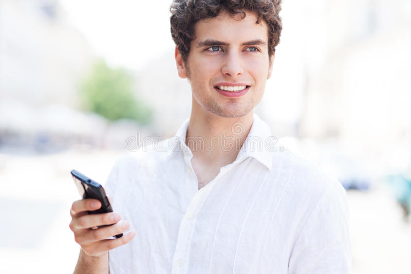 Download Young Man With Mobile Phone Stock Image - Image of student, smile: 32321793