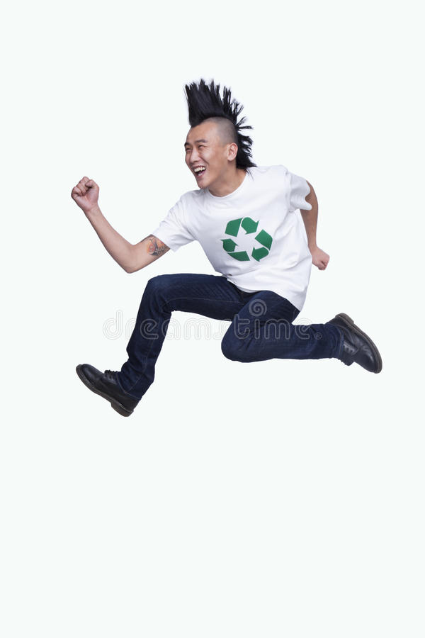 Young man with Mohawk jumping royalty free stock images
