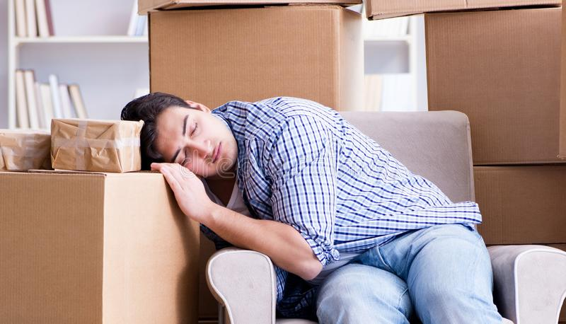 Young man moving in to new house with boxes. The young man moving in to new house with boxes royalty free stock photo