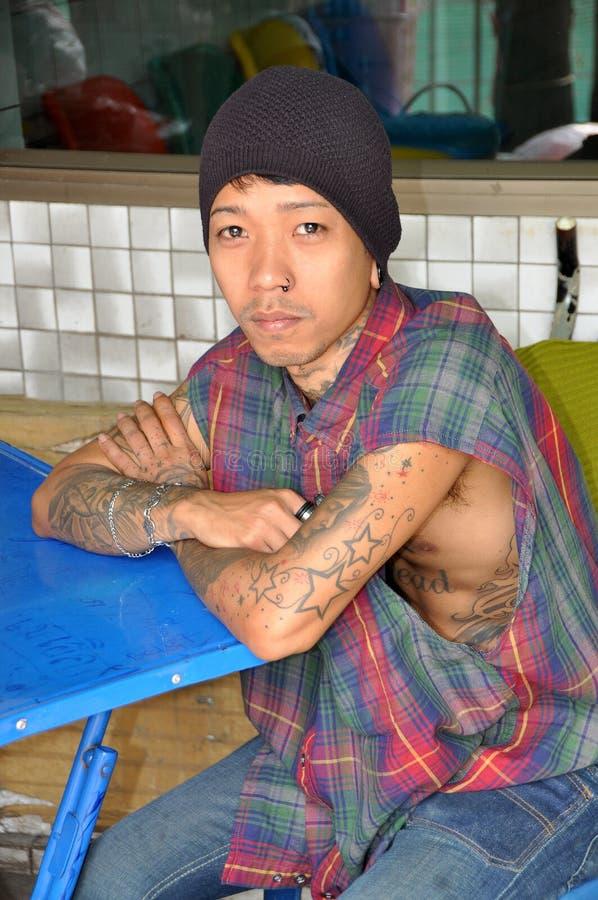 young tattoos multiple tatuaggi giovane body nose multipli editorial tatuaggio sitting siedono vicino dello porta alla che studio si