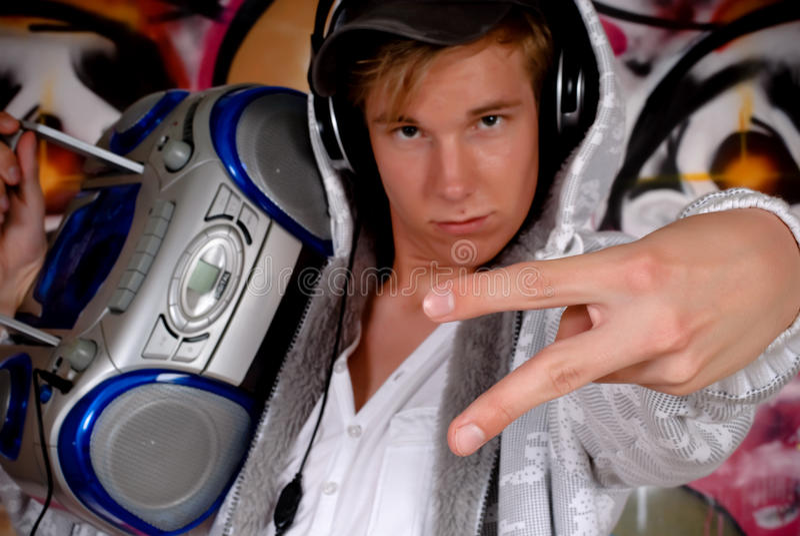 Young man music, graffiti wall stock photos
