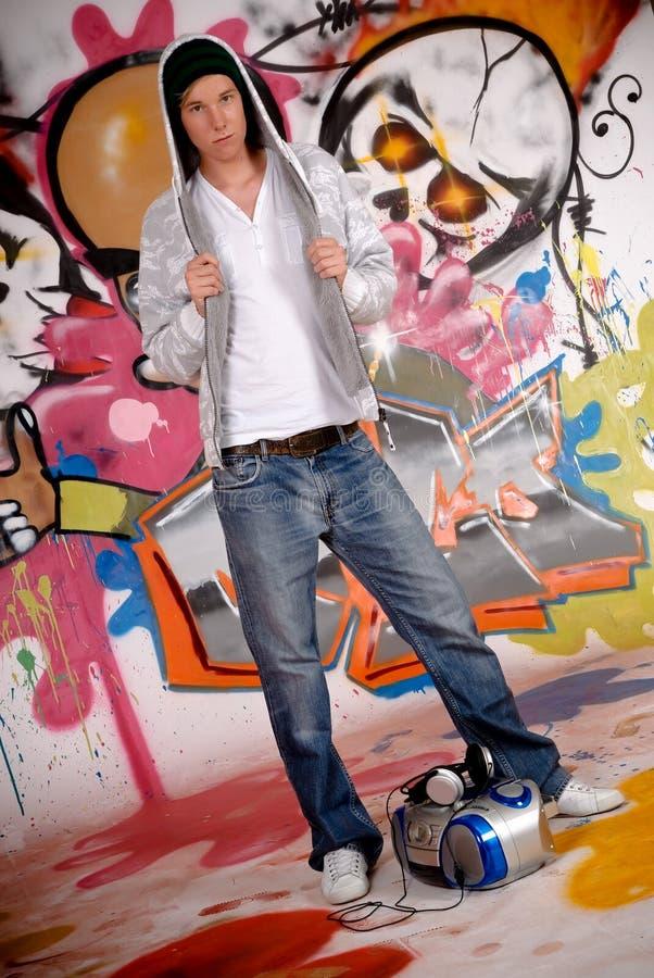 Young man music, graffiti wall royalty free stock images